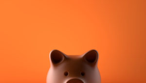 Piggy bank over orange background
